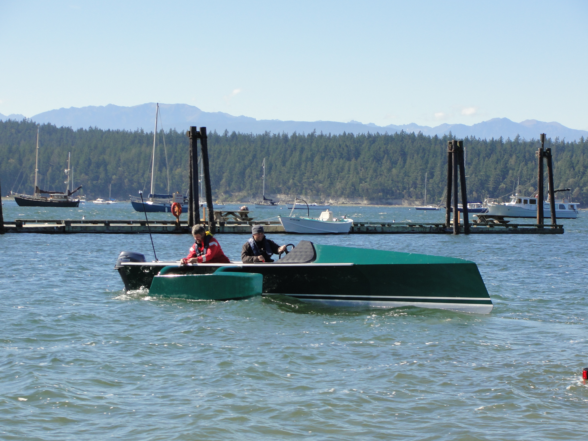 Compare performance of low-power flat-bottomed skiffs vs. catamarans