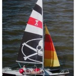 Tremolino trimaran sports a Jolly Roger sail