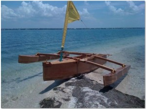 Pretty picture of the double outrigger sailing canoe on the beach